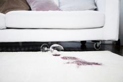 Close up of Spilt red wine on rug