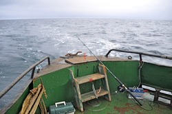 Close-up of spinning bait on the rusty deck of an old trawler floating in the Barents Sea