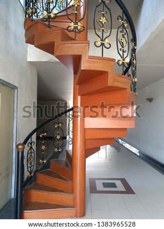 Close up of spiral wooden staircase circular staircase decoration interior with copy space for design #1383965528