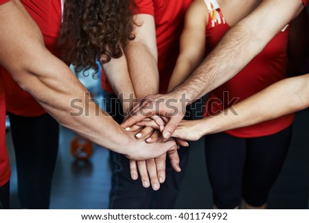 Close-up of sport team stacking hands. Concept of fitness community, partnership and cooperation.