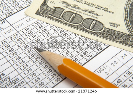 stock-photo-close-up-of-sports-betting-slip-pencil-and-one-hundred-dollars-21871246.jpg