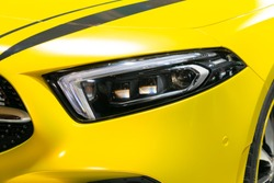 Close-up of sports car headlights.