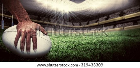 Close-up of sports player holding ball against rugby pitch Сток-фото ©