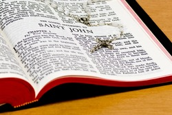 Close up of St John bible page with rosary