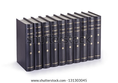 Close up of stack of black books on white background.