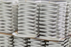 Close-up of stack of books in the industry.