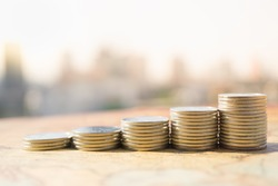 Close up of stack of coins with city background, Money, Financial, Business Growth concept.