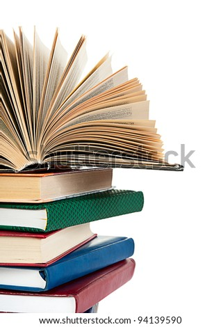 close up of stack of colorful books isolated on white background