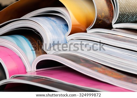 Close-up of stack of colorful magazines. Press, news and magazines concept