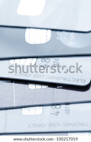 Close up of stack of credit cards toned blue