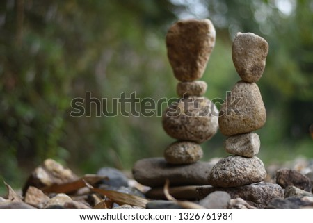 Close-up of stack of stones in perfect balance  accomplish work is successful Stacked stones  , Rock balancing or stone balancing (stone or rock stacking)  #1326761984