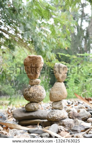 Close-up of stack of stones in perfect balance  accomplish work is successful Stacked stones  , Rock balancing or stone balancing (stone or rock stacking)  #1326763025