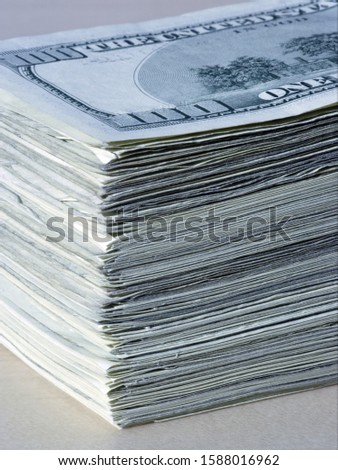 Close up of stack of US one hundred dollar bills