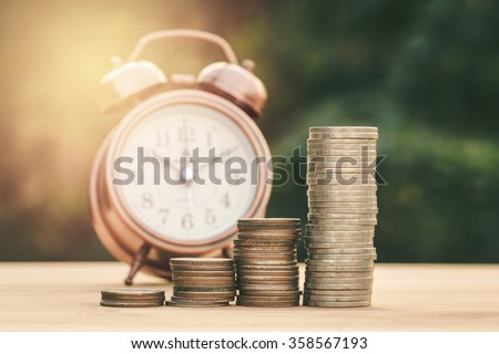 Close up of stacking gold coins with green bokeh background ,Business Finance and Money concept,Save money for prepare in the future.vintage process style
