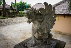 Close up of statue of Singha Barong Winged Lion Spirit (Griffin). Mythical creature in Hinduism of Balinese culture. For daily worship or prayer.