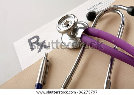 Close-up of stethoscope and prescription form  isolated