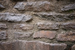 Close up of stone wall with cement. Texture of stonewall