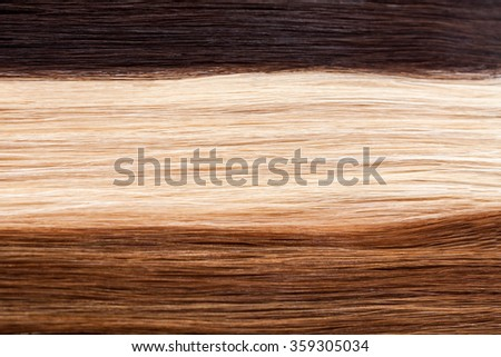 Close up of strait brown, white and dark hair