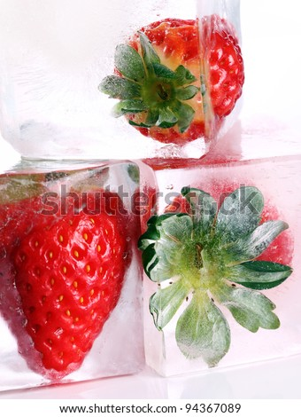 Close up of strawberry frozen in ice