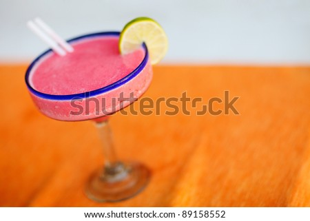 Close up of strawberry margarita cocktail