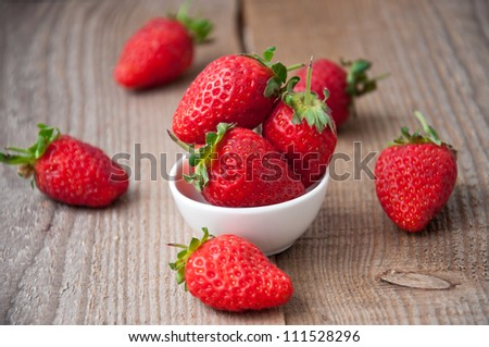 close up of strawberry on wooden background