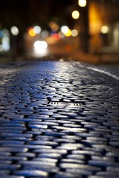 Close up of street with cobble stones at night