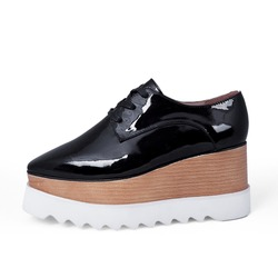 Close up of stylish female shoes boots