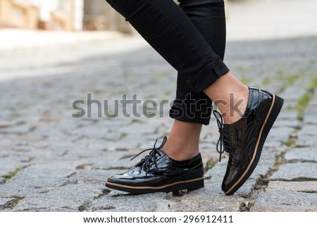 Close up of stylish female shoes.  Outdoor fashion shoes footwear concept. #296912411