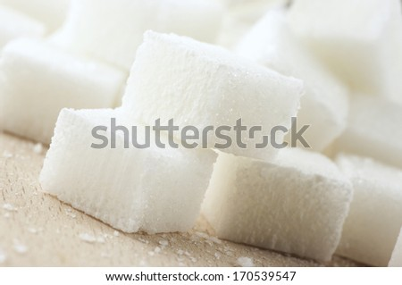 Close-up of sugar cubes on wood. #170539547