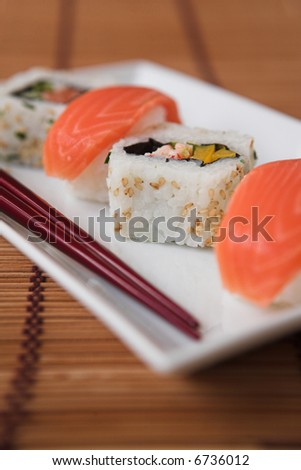 Close up of sushi & chopsticks - shallow dof