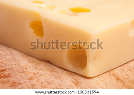 Close-up of swiss emmentaler cheese on wooden board