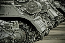 Close up of tank wheels and front part of the tank, located at historic cultural complex called Stalin Line fortifications along the western border of the Soviet Union in Minsk