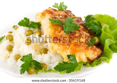 Close up of Tasty Chicken baked with pineapple and cheese dish with rice vegetables garnish