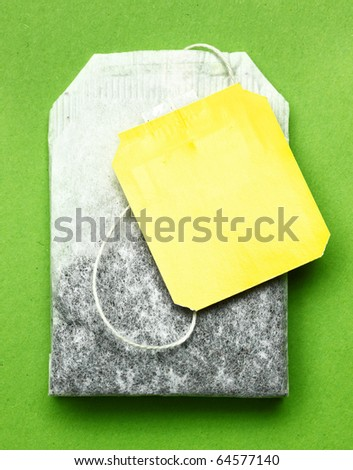 Close-up of tea bag on green placemat.