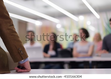 close up of teacher hand with marker while teaching lessons in school  classroom to students