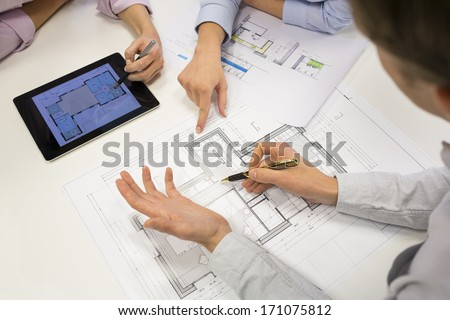 Close-Up Of Team Architects Working On Construction Project In Office