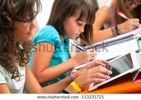Shutterstock Close up of Teenage girls doing homework.