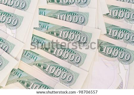 close up of ten thousand iraqi dinar notes - stock photo
