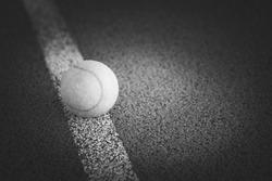 Close up of tennis ball on a tennis court.
