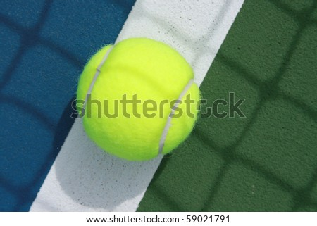 close up of tennis ball on the boundary line