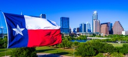 Close up of Texas Flag patriotic National Pride Displays the Lone Star State with a Colorful Austin Texas Skyline Cityscape Capital Cities Background on a Nice Sunny Summer Blue Sky Day