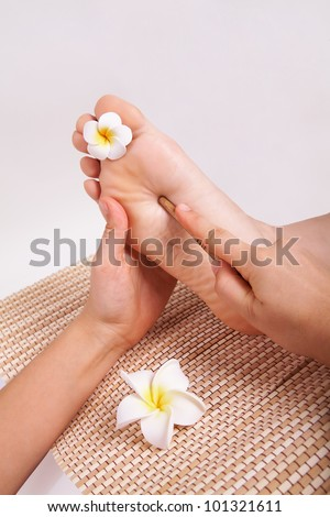 Close-up of thai massage foot female isolated on white background
