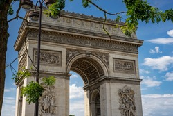 Close-up of the Arc de Triomphe, one of the most famous monuments in Paris France, standing at the end of the Champs-Elysees at the center of Place Charles de Gaulle, formerly named Place de l'Etoile