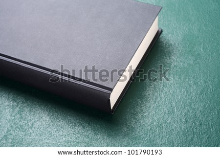 close up of the book on the black board