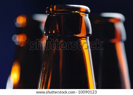 Close-up of the brown glass bottle necks. Narrow depth of field.
