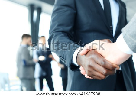 Close up of the businessmen shaking hands. - Shutterstock ID 641667988