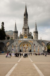 Close up of the Cathedral of Lourdes in France. Cloudy day.