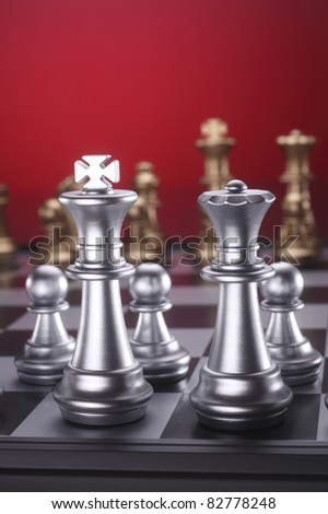 close up of the chess game on the king and queen