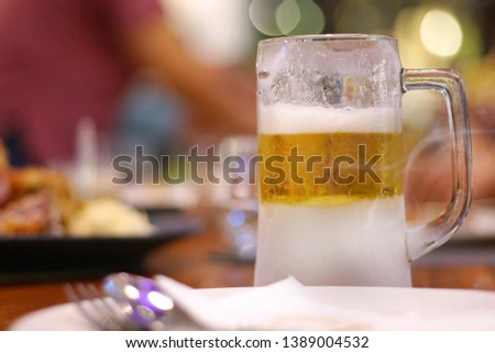 Close up of the cold glass beer with froth. Good view of Pub & restaurant concept.