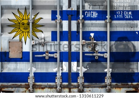 Close-up of the container with the national flag of Uruguay. The concept of Uruguay  export-import and national delivery of goods. #1310611229